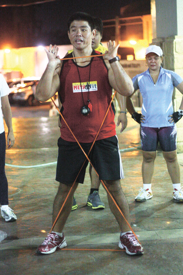 PULL! Choachuy guides participants at the Persimmon Plus grounds on how to use the elastic band as a workout tool.