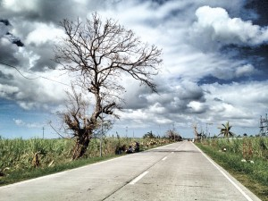 THE ROAD. A long lonely stretch up northern Cebu, post-Yolanda.