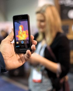 TAKING THE HEAT. The FLIR ONE thermal imager for the iPhone is demonstrated at the International Consumer Electronics Show. The event was held earlier this month in Las Vegas. (AP FOTO)