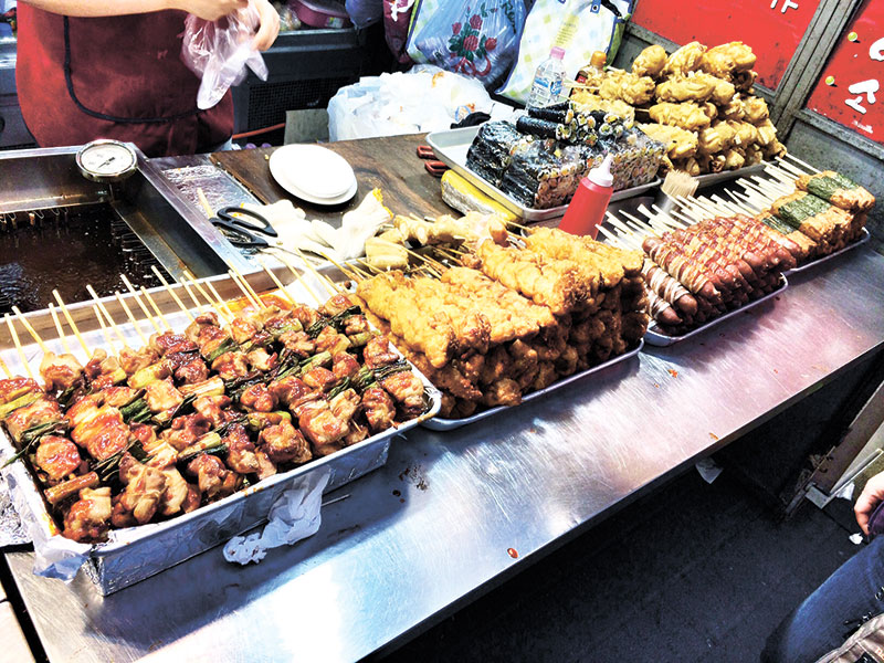 Grilled Chicken on a Stick (super yummy!), Crispy Fried Chicken on a Stick (to die for!), Bacon-Wrapped Hotdogs, Fish Cakes wrapped in Seaweed Tokkebi Hotdogs, and Kimbap (Rice Rolled in seaweed paper and stuffed with crab, turnip, and cucumber)