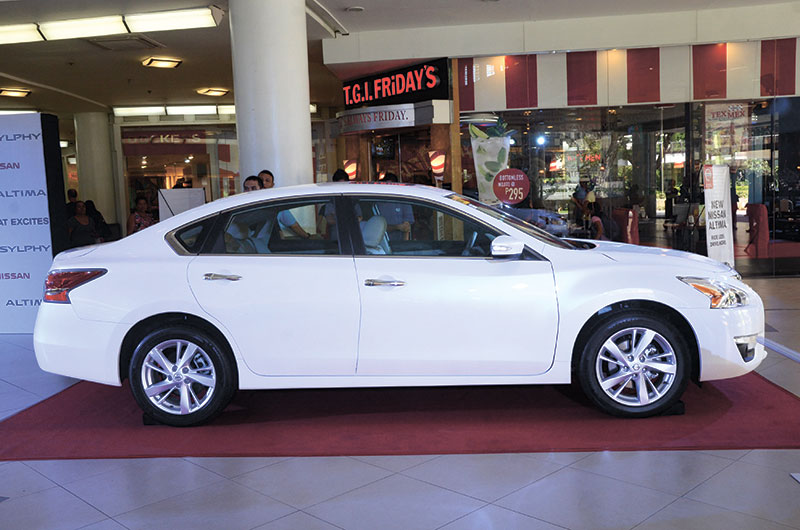 AERODYNAMIC. A sloping rear roofline and a high trunk lid  gives the new Nissan Altima a premium look.