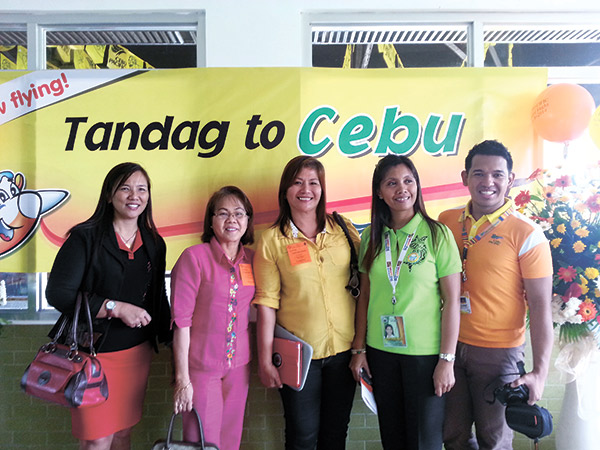 Department of Tourism Caraga Regional Director Leticia Tan (second from left), Tandag City Tourism Officer Florence Abis (fourth), CEB's Claude Ramos (fifth) together with guests.