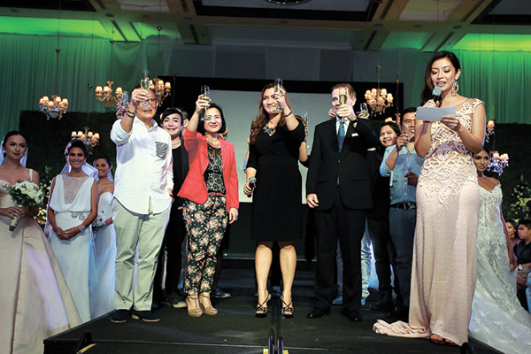 Cebu City Marriott Hotel executive committee members propose a toast together with the evening's featured designers.