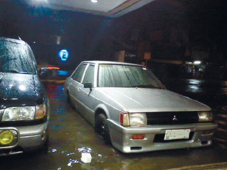 Parked cars in a flooded area in Metro Cebu