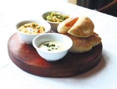 Hummus, Babaganouj and Tahina with warm Moroccan Bread