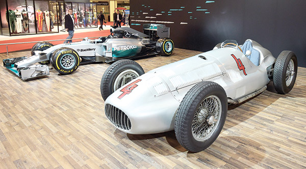 FAST CARS. A Mercedes race car from 1938 stands beside the current Mercedes Formula One 2014 world champion car at the Essen Motor Show, a show for tuning, motor sport, series sports vehicles and classic cars. The event was held late last month. (AP FOTO)