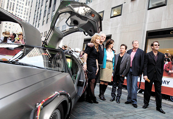 """BACK TO THE FUTURE. Cast members of the """"Back to the Future"""" movies appear on the NBC """"Today"""" television program on Oct. 26, 2010, commemorating the 25th anniversary of the films, in New York. Posing with a replica of the DeLorean car, they are (from left) Lea Thompson, Christopher Lloyd, Mary Steenburgen, Michael J. Fox, director Robert Zemeckis, and Huey Lewis. """"Back to the Future,"""" first released on July 3, 1985, celebrates its 30th anniversary in 2015. (AP FOTO)"""