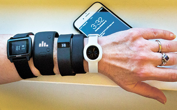 FITNESS trackers (from left): Basis Peak, Adidas Fit Smart, Fitbit Charge, Sony SmartBand, and Jawbone Move, all of which are iPhone-compatible. (AP FOTO)