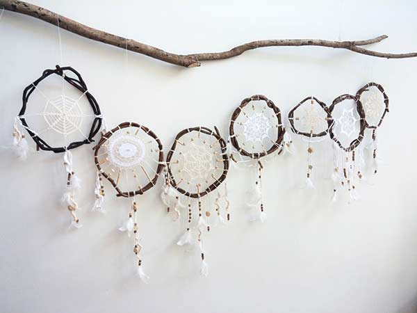 TWIGS AND THREADS. Web-like patterns are woven inside circular twig hoops, then adorned with feathers and beads to make dream catchers, such as these crafted by Cebu-based artist and poet Karla Quimsing of Damgo. (CONTRIBUTED FOTO)