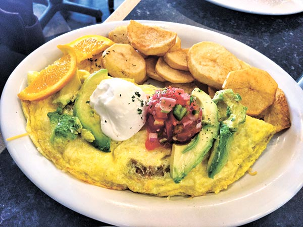 Cali Omelet with Cheddar Jack Cheese, Sour Cream, Sausage, Pico de Gallo and Avocado