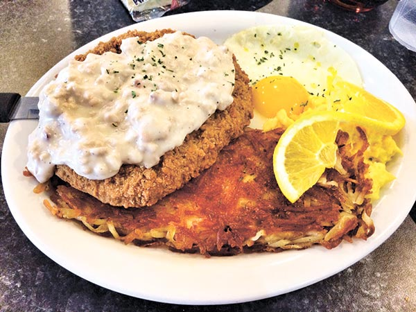 Mamas Chicken Fried Steak and Eggs with Sausage Gravy and Hash Browns