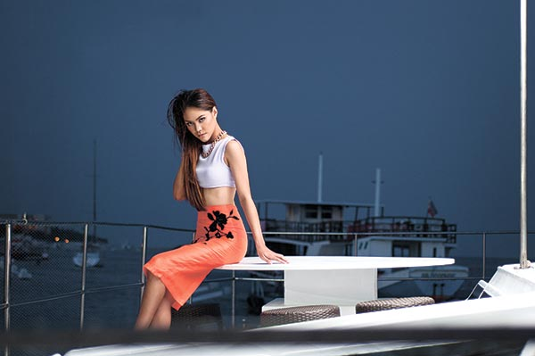PREPPY PAIR. Lilac neoprene top paired with an orange high-waist pencil skirt.