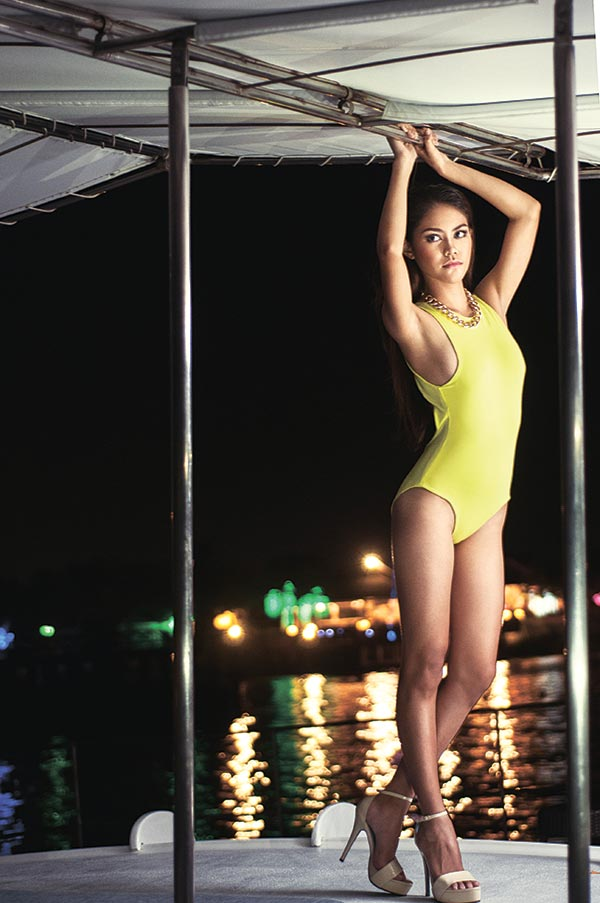 SEA SPECTACLE. One-piece swimsuit in a striking yellow-green hue.