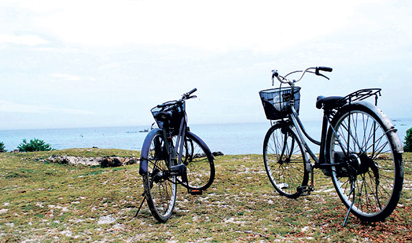 BEACHES AND MORE. One of the best ways to enjoy Sta. Fe, apart from frolicking in its pristine white beaches, is biking through its scenic rolling terrain.  (Photo by Marian C. Baring)