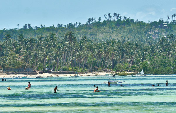 A STRETCH OF WHITE. San Remigio is known for its beach, said to be the longest shoreline in mainland Cebu. (SUN.STAR FILE)