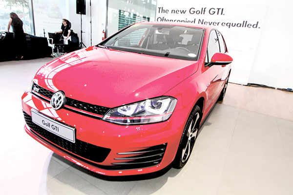 """PREMIUM DESIGN. Inviting in its own way is how Peachy Hapitan, General Sales Manager and Branch Officer in Charge of the Volkswagen Showroom Cebu, describes the Golf GTI with its modest exterior. """"It has its own kind of appeal that draws you in to experience it,"""" she said. """"Immediately, you'll notice its classic and premium design, but once you engage yourself, you'll realize it is an entirely different animal."""""""