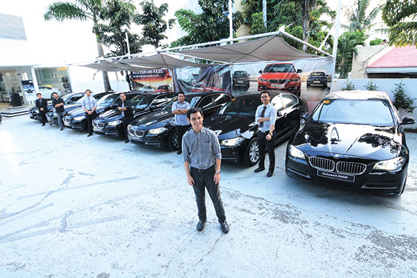 BMW 520D FLEET. Michael Goho, executive vice president of Gateway Motors Group, with the Autowelt BMW team outside their showroom in Nivel Hills, Cebu City.