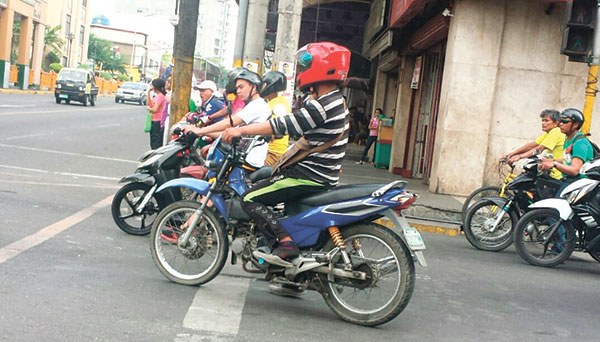 KINGS OF THE ROAD. Motorcycles block the pedestrian lane at the corner of Junquera and P. del Rosario Sts. in Cebu City.