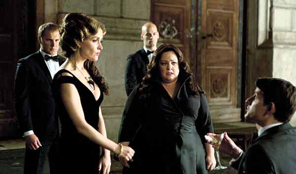 """IN a scene from the film """"Spy,"""" Melissa McCarthy (second right) infiltrates an arms dealing ring led by Rose Byrne (left). (AP FOTO)"""