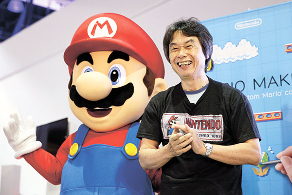HALL OF FAMER. Japanese video game designer Shigeru Miyamoto with Super Mario at last year's Electronic Entertainment Expo in Los Angeles. (AP FOTO)