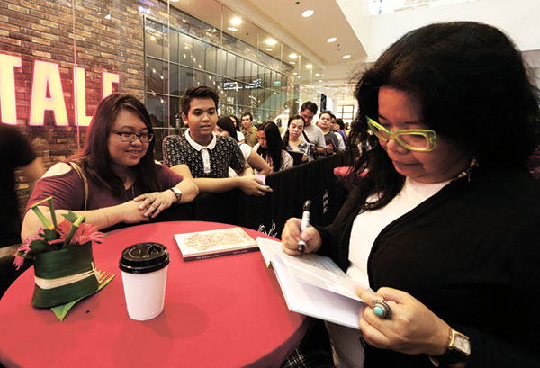 "JESSICA ZAFRA. The writer from Manila signs copies of ""The Stories So Far,"" one of two books she launched during the festival."