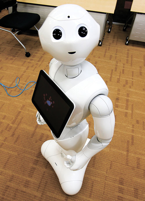 MEET PEPPER. SoftBank Corp.'s new companion robot Pepper is a four-foot tall white machine-on-wheels that offers ardent attention, cool dance moves, and small talk. Pepper has cameras, lasers and infrared in its hairless head so it can detect human faces. (AP FOTO)