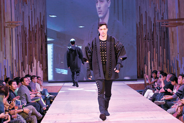 """SAMURAI SENSE. One of the featured Mensweek 2015 designs by Cary Santiago, who says of her work: """"Inspired by the samurai, the collection features neoprene fabric with embossed sculptured fabric. Incorporating the 3D details, the shape and silhouette is after the samurai garment."""""""