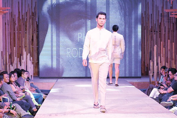 """GOING VINTAGE. Philip Rodriguez on his designs: """"The collection is called 'Keepsakes.' Vintage postcards from colonial Cebu were printed on the linen and crepe fabrics all mixed together to form a wonderful collage of varied fabric textures and lace in different silhouette to represent modern resort wear so reflective of Cebu."""""""