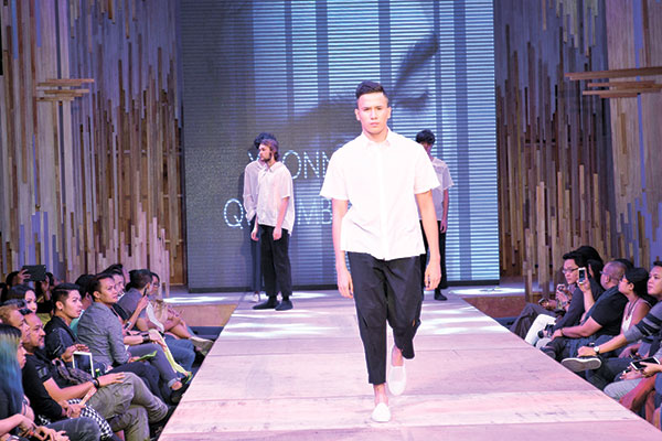 """CLEAN CUT. A model dons one of the designs of Yvonne Quisumbing, the lone female designer featured in Mensweek 2015. """"The fabrics are cottons to suit our weather. The cuts are simple and straightforward. The details, which are the clean slits, unite the whole collection,"""" said Quisumbing of her designs."""