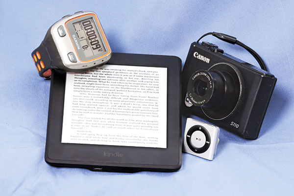 BETTER? A Garmin Forerunner 310XT GPS Sports Running Multisports Speed & Distance Watch, an Amazon Kindle, Apple iPod Shuffle, and a Canon S110 camera. There are times a stand-alone device works better than a jack-of-all-trades like a smartphone. (AP PHOTO)