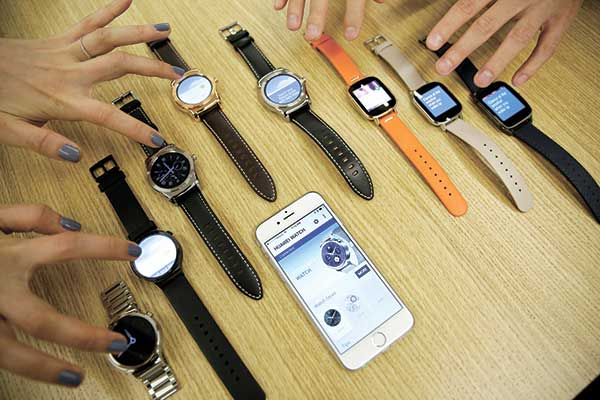 STRAP WARS. Google is introducing an application that will connect Android smartwatches with Apple's iPhone, escalating the rivals' battle to strap their technology on people's wrists. (AP PHOTO)