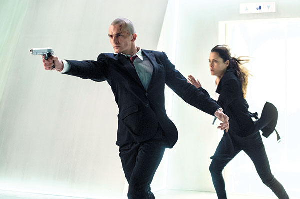 """Rupert Friend (left) and Hannah Ware in a scene from, """"Hitman: Agent 47."""" (AP PHOTO)"""