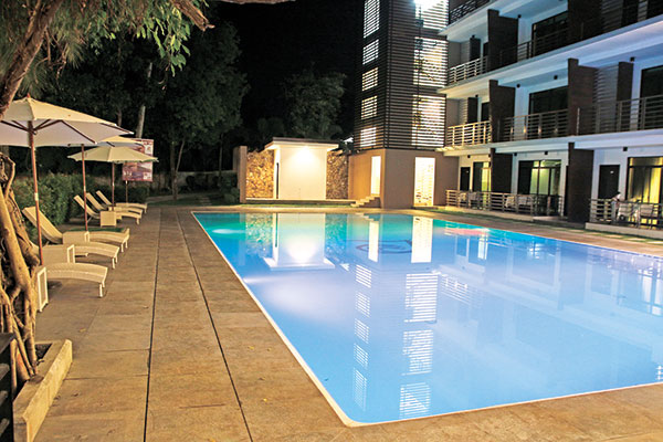 POOLSIDE ROOMS. One of Paulo Luna's three pools, a large rectangular shaped pool with both shallow and deep ends, excellent for doing laps. The resort also has 42 rooms, as well as a gym and spa, among other amenities.