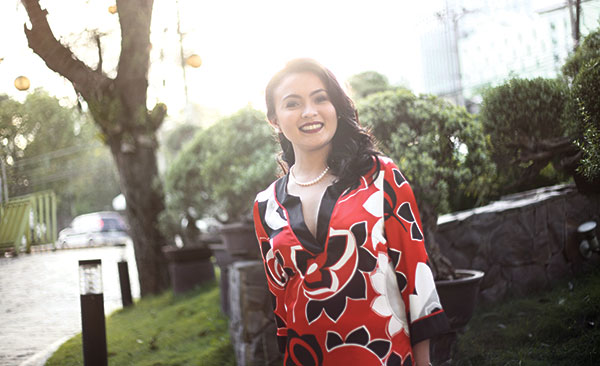 GOING UP. At first when Aeda Mae Siao gave the real estate industry a try, she thought she wouldn't last long. After four years and countless highs and lows, she's now the international sales and marketing manager for Grandland Residences.