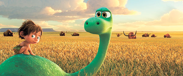"Spot, voiced by Jack Bright, left, and Arlo, voiced by Raymond Ochoa, in a scene from ""The Good Dinosaur."" (AP PHOTO)"