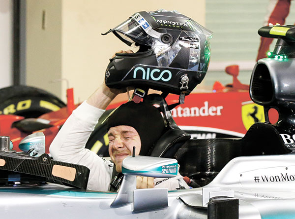 HAT TRICK OF WINS. Mercedes driver Nico Rosberg of Germany shortly after winning the Emirates Formula One Grand Prix at the Yas Marina racetrack in Abu Dhabi, United Arab Emirates last Nov. 29. Rosberg completed a hat trick of victories to end the Formula One season when he won the Abu Dhabi Grand Prix, profiting from a questionable tire strategy by his Mercedes teammate Lewis Hamilton. (AP PHOTO)