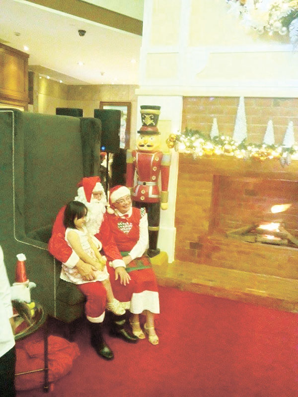 Picture taking with Mr. and Mrs. Claus