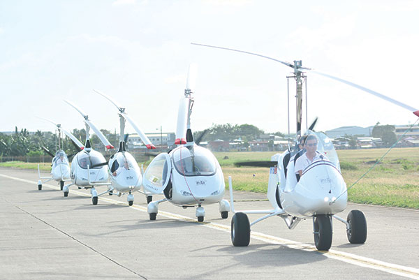 READY TO FLY. Six gyrocopters were flown to demonstrate the machine's capabilities and safety features.