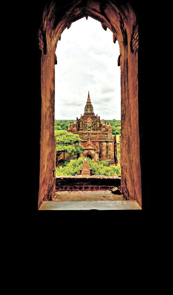 An ancient temple in Old Bagan as seen through a window of a temple that's as ancient.
