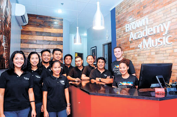 BAM DIRECTORS, FACULTY AND STAFF. Front (from left): Veronica Towers-Dioso (Children's Music), Ana Dominique Casas (Violin), and Analou Dacula (Administrative Assistant). Back (from left): Oking Danong (Drums), Allan Aum (Keyboard), Rey Basalo (Winds), Rich Aliño (Guitar and Bass Guitar), Aya Lapalam (Voice), Chris Lorenzo (Voice), Adam Brown, and Anna Fegi-Brown.