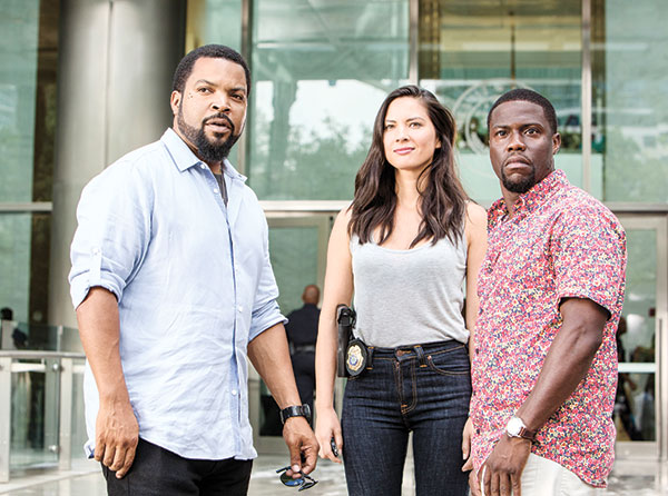 "Ice Cube (from left) as James Payton, Olivia Munn as Maya Cruz, and Kevin Hart as Ben Barber in a scene from the film, ""Ride Along 2."""
