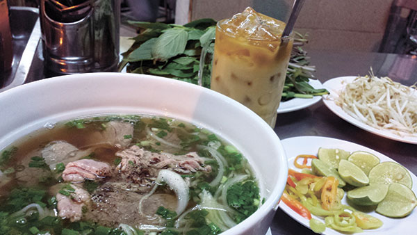 Beef noodles, or Pho, with milk tea at Pho Quunh