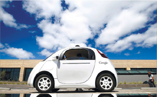 """AGREED. Google's new self-driving car during a demonstration at the Google campus in Mountain View, California. The federal government's highway safety agency agrees with Google: Computers that will control the cars of the future can be considered their driver. The redefinition of """"driver"""" is an important break for Google. (AP PHOTO)"""