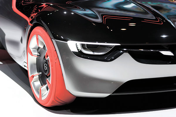 SEEING RED. The new concept car Opel GT Concept with a red tire displayed at the 86th International Auto Show in Geneva, Switzerland. The Auto Show, which was slated to run from March 3 to 13, presented more than 200 exhibitors and more than 120 world and European premieres. (AP PHOTO)