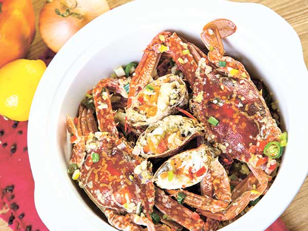 """Crabs in garlic butter sauce. f/8, 1/160, ISO 100, 2 strobe lights with 60"""" and 40"""" umbrella. Shooting for long-time friend Ace Rivera. Salt Seafood is located at St. Patrick Square near Redemptorist Church."""