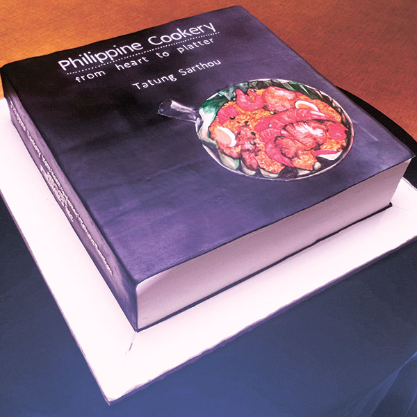 Huge book cake created by Chef Edward Mateo