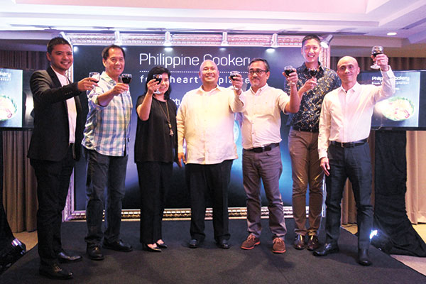 (From left) ABS-CBN Publishing Managing Director Mark Yambot, Chef Sandy Daza, Food Magazine and Heart to Platter editor Nana Ozaeta, Chef Tatung, award-winning book designer and food writer Ige Ramos, bestselling cook book author and F&B Report editor Angelo Comsti, and ABS-CBN Publishing President Ernie Lopez. (Photo by Eds Capili)