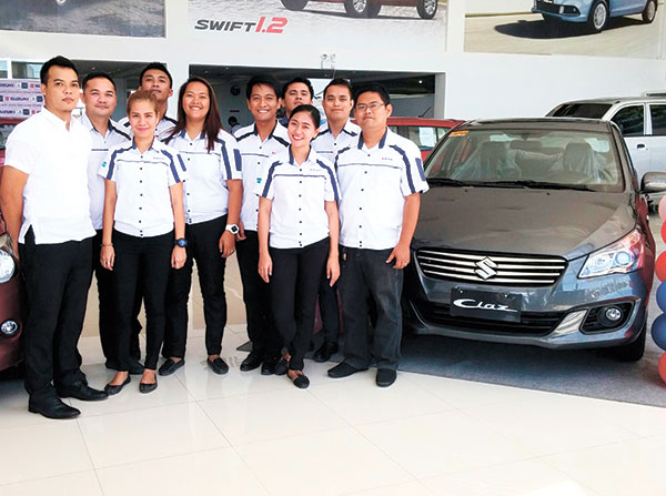 The staff of Suzuki Auto South Cebu with the New 2016 Suzuki Ciaz at their showroom in SRP, Mambaling. (CONTRIBUTED PHOTO)