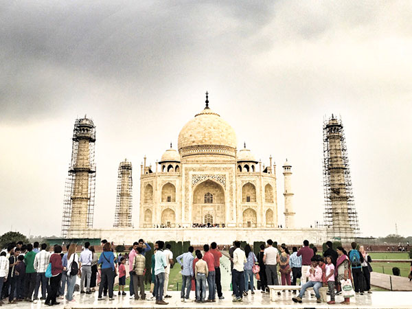 Cloudy skies and some rain never stopped the tourists from admiring the Taj Mahal.
