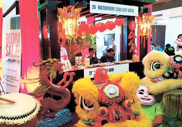 Dragon dancers gather in front of the Waterfront Cebu City Hotel and Tin Gow booth. Waterfront won as Best City Hotel, while Tin Gow as Best Chinese Restaurant.